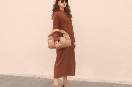 Ta sukienka na jesień to hit sezonu. Sprawdzi się w chłodniejsze dni. Zobacz, jak noszą ją dziewczyny na Instagramie!